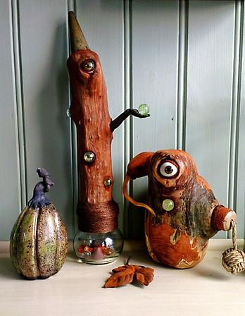 Raku-pumpkin and two wooden sculptures