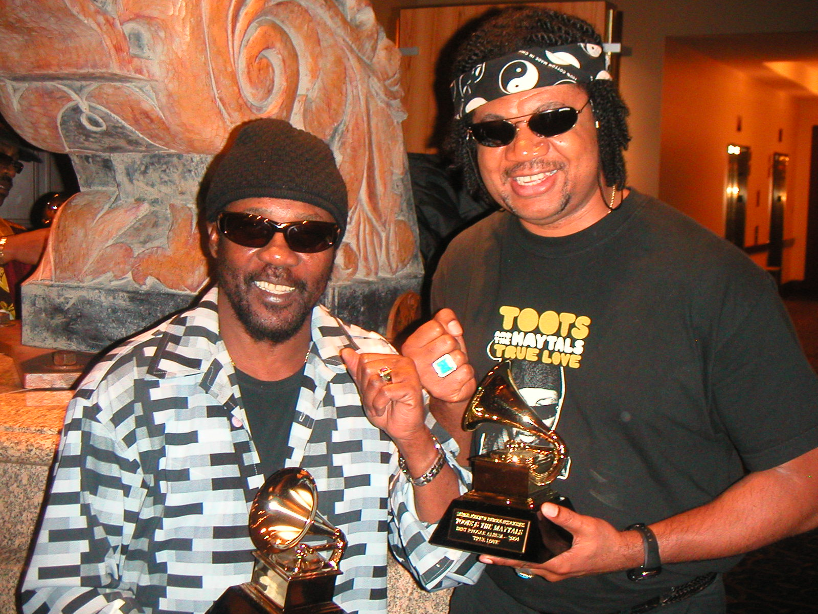 Toots and Carl holding the Grammies