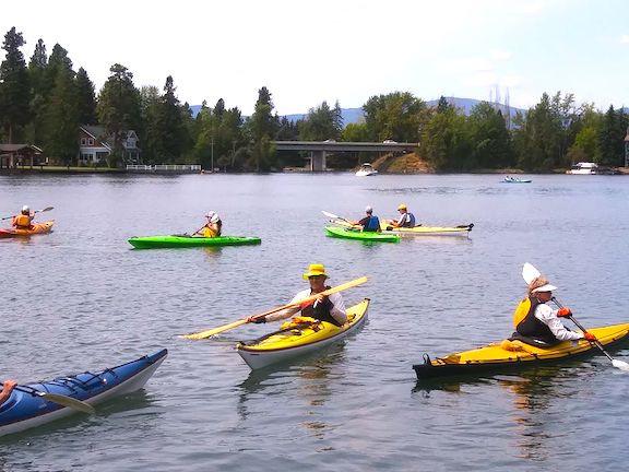 Kayakers on Bigfork Bay on Flathead Lake, just outside of Swan River Inn in Bigfork, during the Poker Paddle