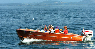 wood boat on flathead lake, swan river inn, bigfork montana, activities in the flathead valley montana, family boating