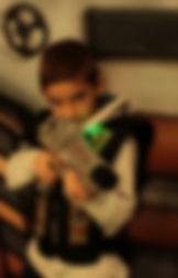 Joueur de l'équipe verte, laser games.  Jeu à partir  de 6 ans