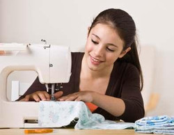 139994-393x305-kid-with-sewing-machine