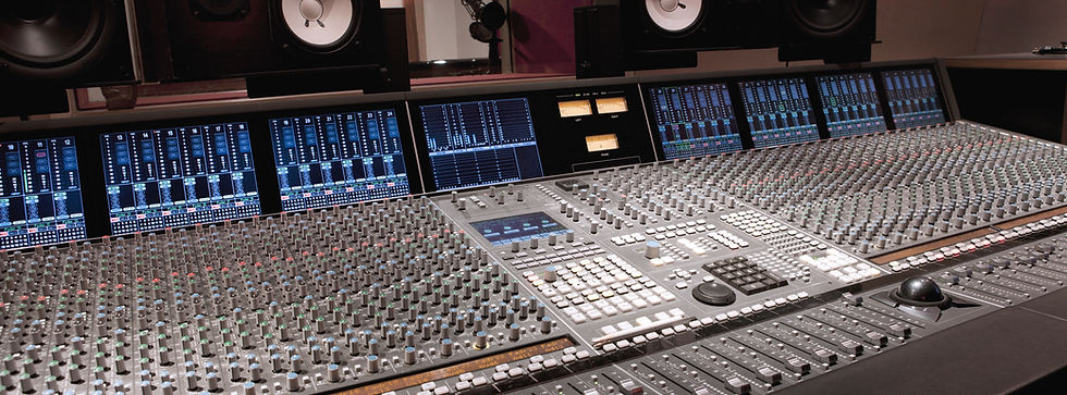 A music studio mixing console
