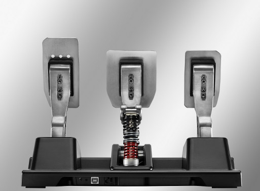 A photo of the back of Thustmaster´s T-LCM pedals with a focus on the six springs it uses to adjust the sensibility of the brakes.