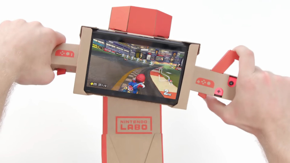 A picture of the bike Toy-Con from the Labo being used to play Mario Kart 8