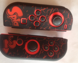 A pair of Joy-Con with a Splatoon 2 skin.