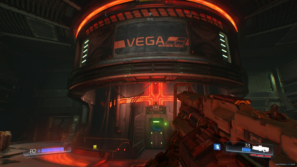 A screenshot of DOOM where the Doomslayer is looking at VEGA´s core.