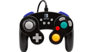PowerA´s black  Wired Pro Controller that is made to look like a Gamecube gamepad behind a white void