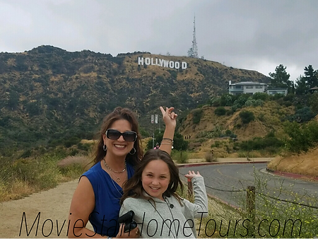 LA tourists at the Hollywood Sign on the hollywood homes tour.