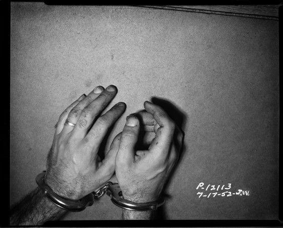 cuffed hands.jpg
