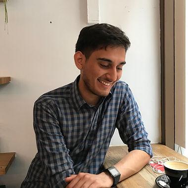 Dhruv in a coffee shop