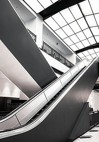 black-and-white-escalator-inside-buildin