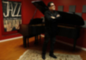 Lannie with piano.jpg