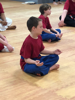Little boy sitting cross legged