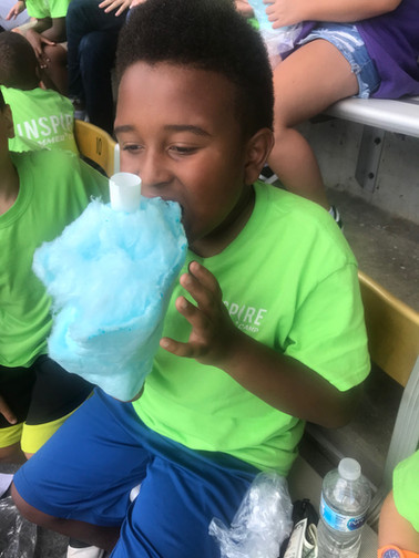 Summer Camp Boy eating cotton candy.jpeg