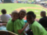 Summer camp kids at baseball game