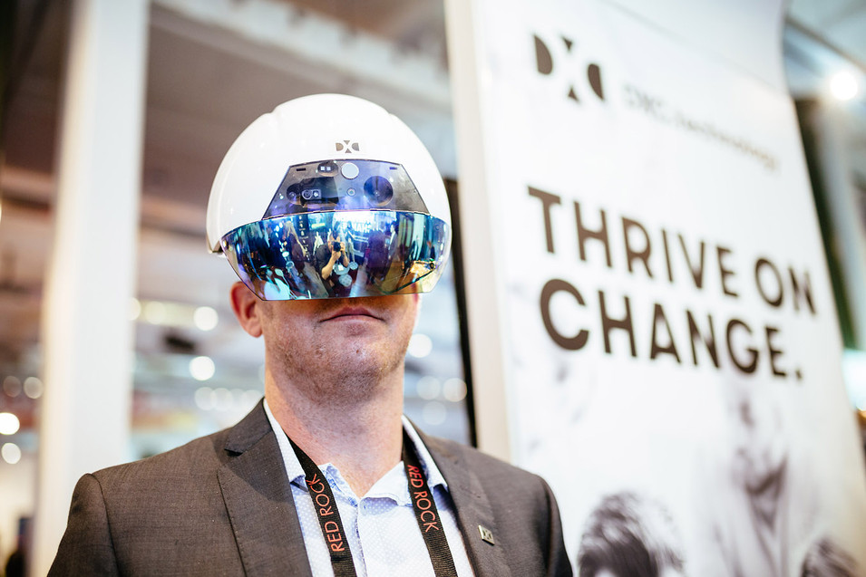 dynamic event photography of virtual reality helmet at a conference.