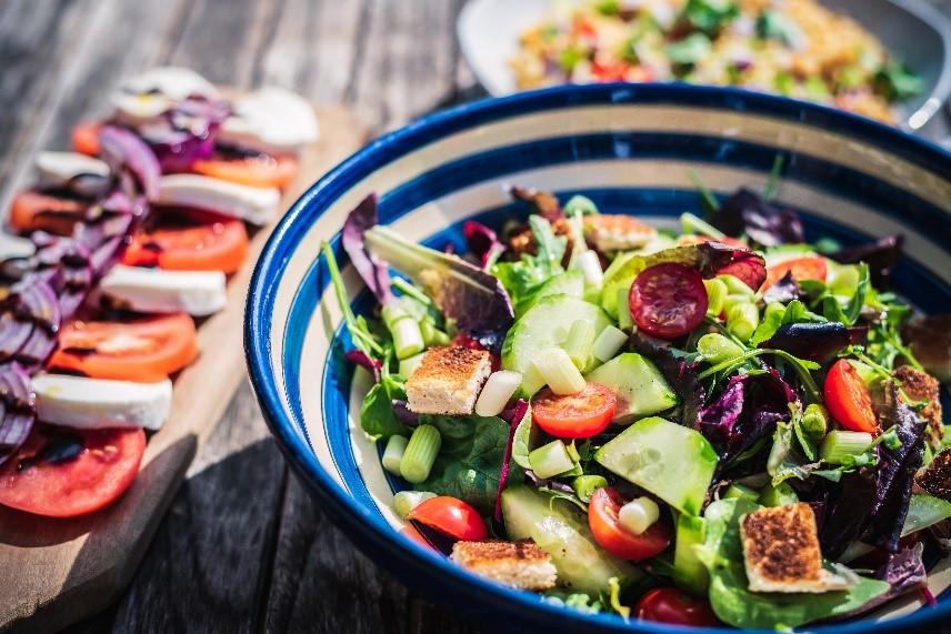 Salad in striped blue bowl