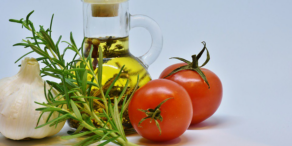 Tomatoes, rosemary herb, garlic head, olive oil bottle