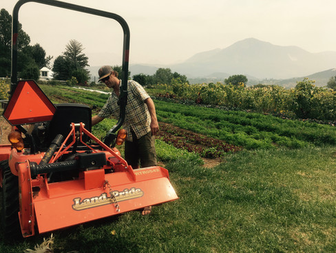 Eric firing up the tractor on a hazy day