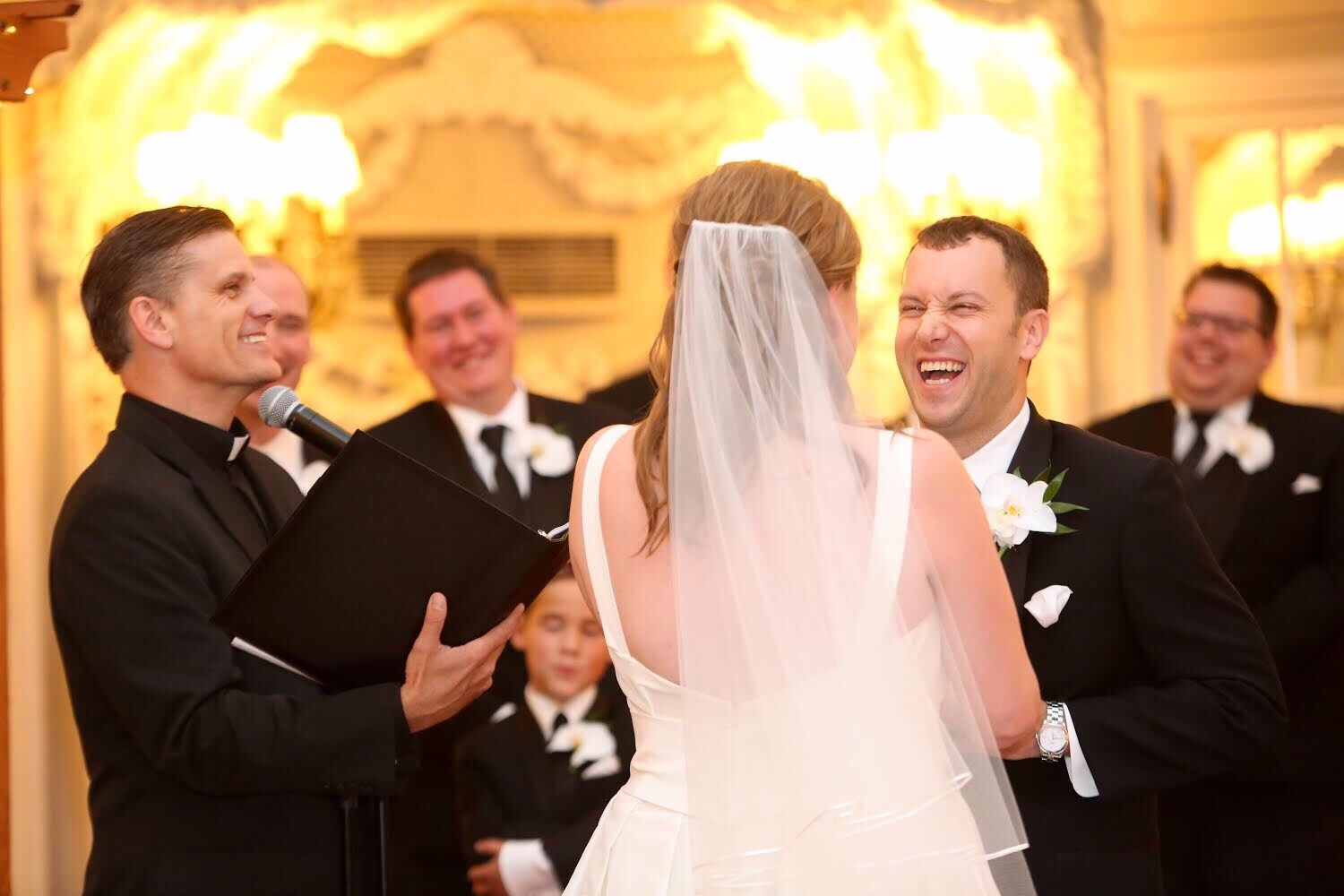 Laughing Groom and wedding officiant