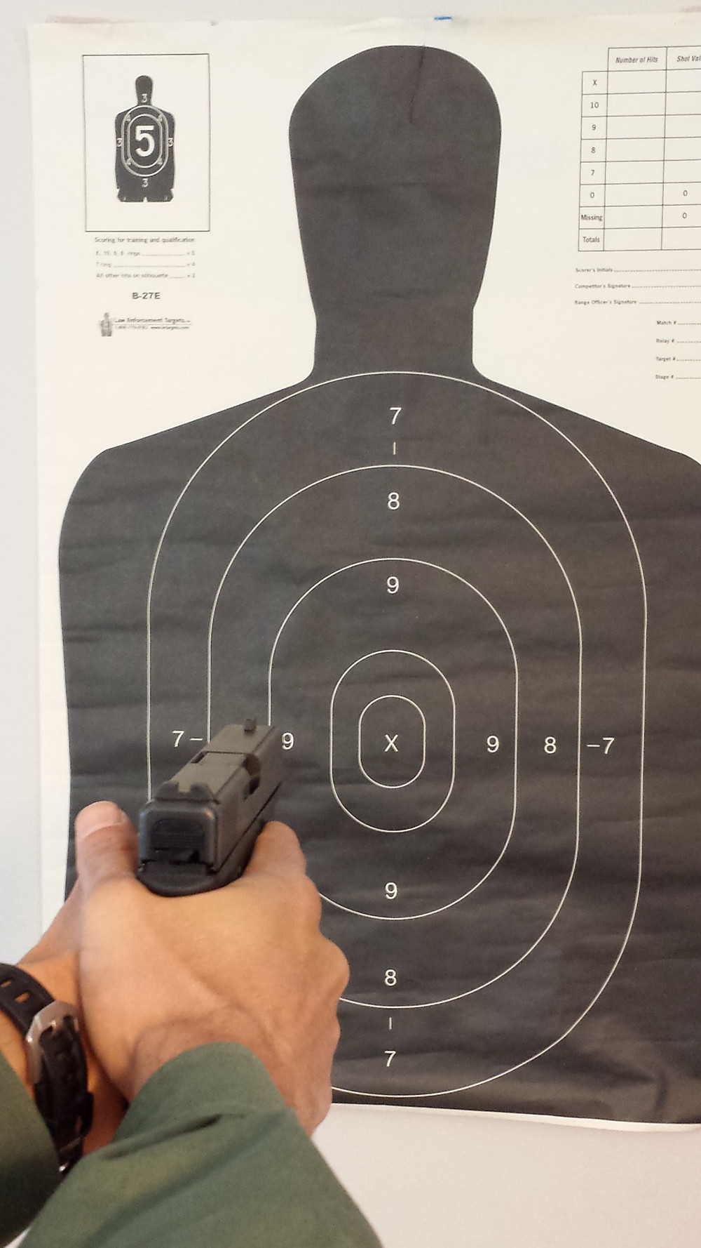 Target and proper pistol grip and alignment