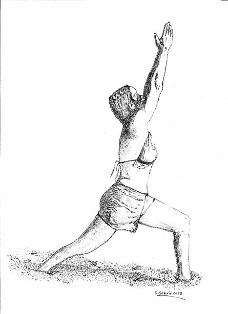 Woman on the beach in a yoga pose: warrior 1
