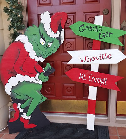 Grinch yard art and sign