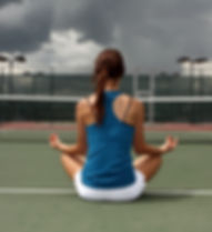 Female Tennis player meditating before t