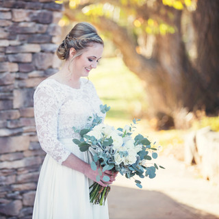 Bridal portrait with green and white bouquet