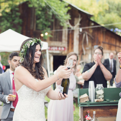 Popping champagne at Avalanche Ranch