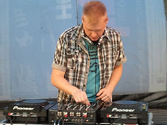 Profile picture of Dj Jerry Borygo in the mix behind the decks. Stage, Pioneer Dj Console, CDJ and mixer.