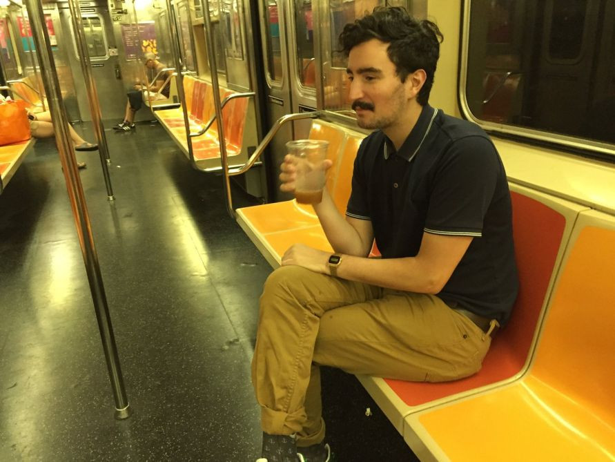 man carrying open container on nyc subway train