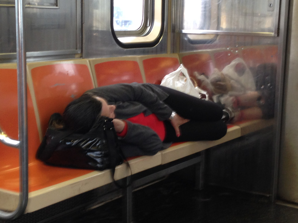 Woman Sleeping on the 1 train takes up 4 seats #4