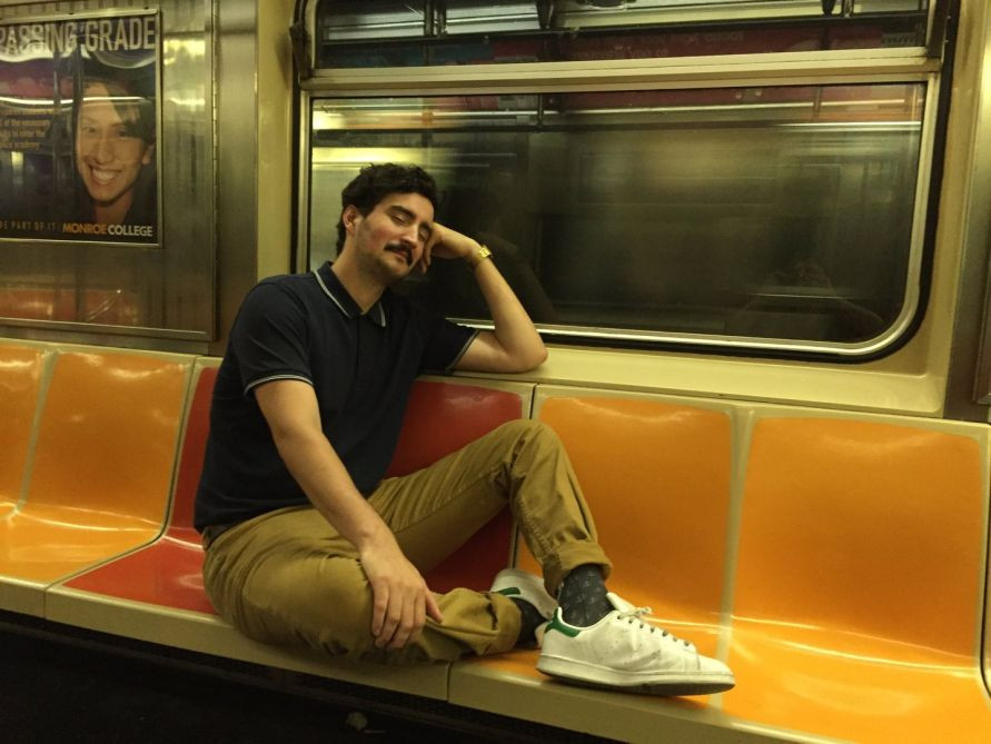 man obstructing seats on nyc subway train