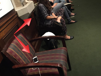 Woman Uses Empty Seat to Charge Cell Phone at a Packed 92Y Event