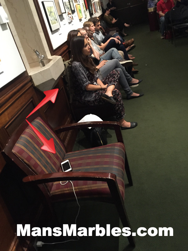 Woman hogs a seat to charge her cell phone at 92y event #1
