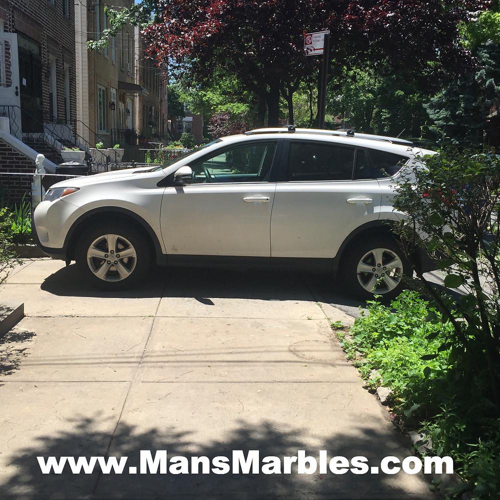 Car parked on sidewalk instead using their driveway #1