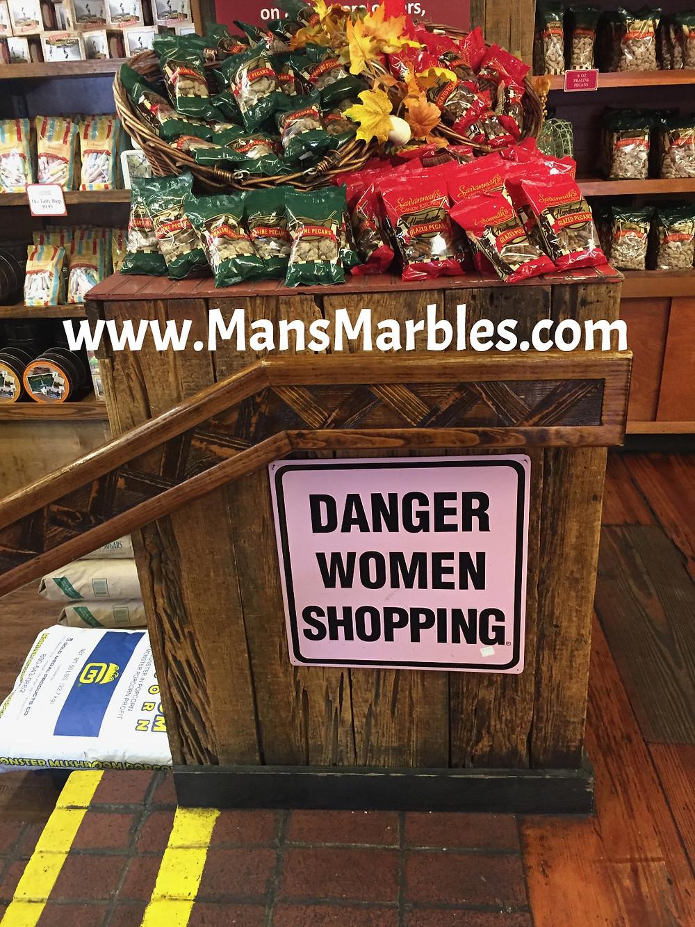 Danger women shopping sign at River Street Sweets