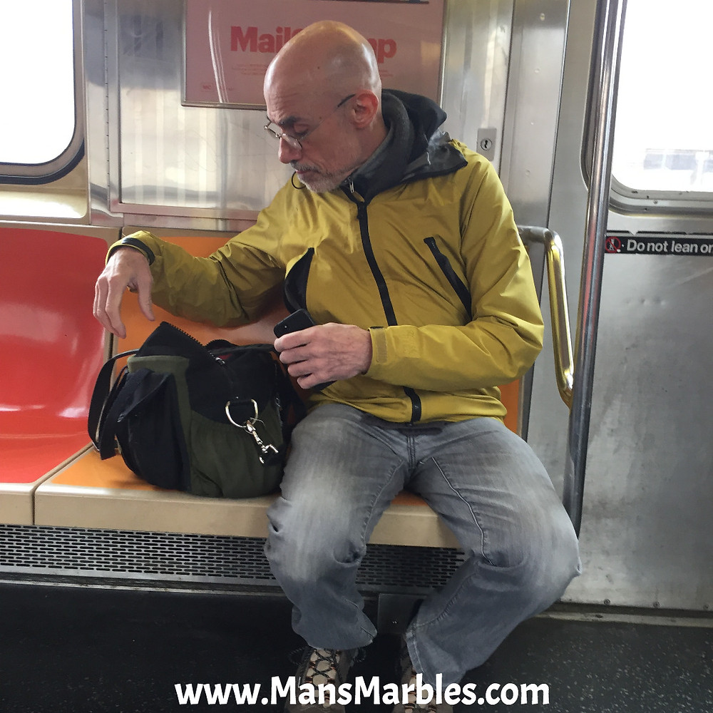 Manspreader hogs a nyc subway seat with his bag