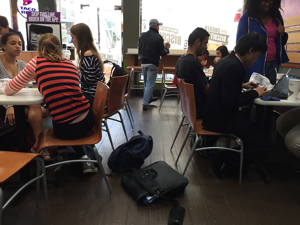 Students bagpreading on the floor in Taco Bell, forces man to step over them #6