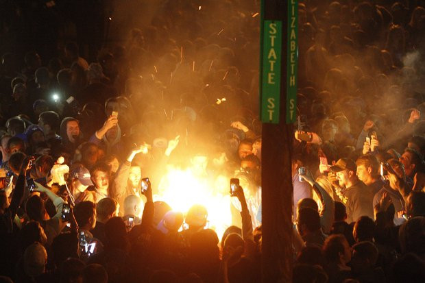 Kentucky Fans setting fire on stae street after wildcats lose final four to badgers
