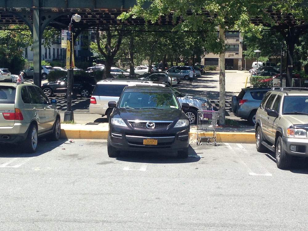 Bad park job, parked perfectly to take up 2 spaces