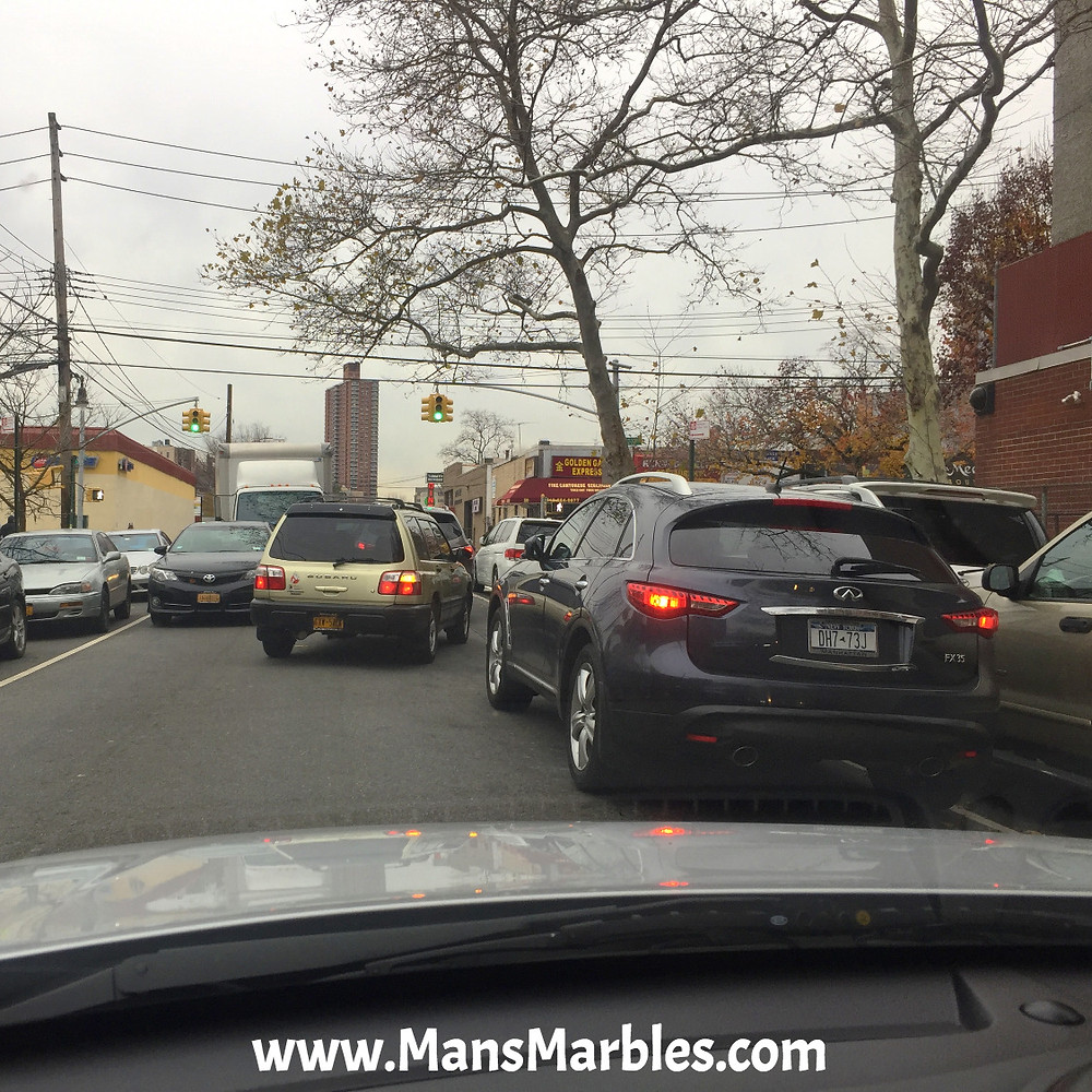 Idiot driver Double Parks car before Green Light