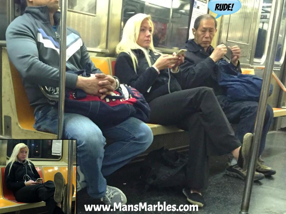 Girl rudely blocks subway train aisle by crossing her legs