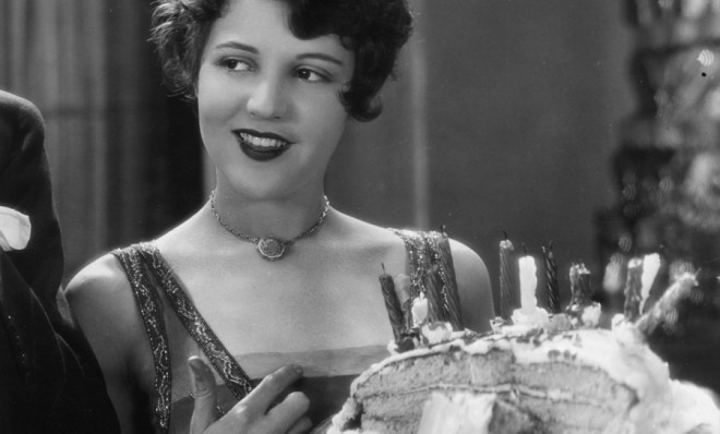 A woman making sure to eat the last slice of cake so she wouldn't be rude