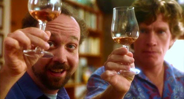 Image from the movie Sideways, Paul Giamatti and Thomas Haden Church analyzing a snifter of whiskey
