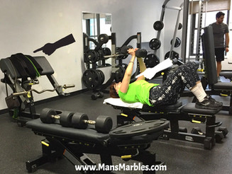 Woman Using Weight Machines As a Coat Rack at the Gym