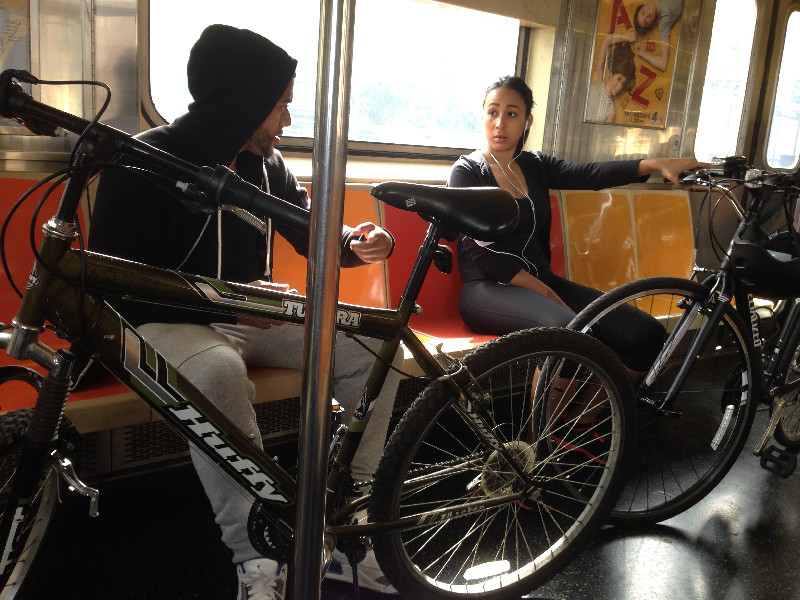 2 Bikers Taking Up a Full Row of Seats on the Train #2
