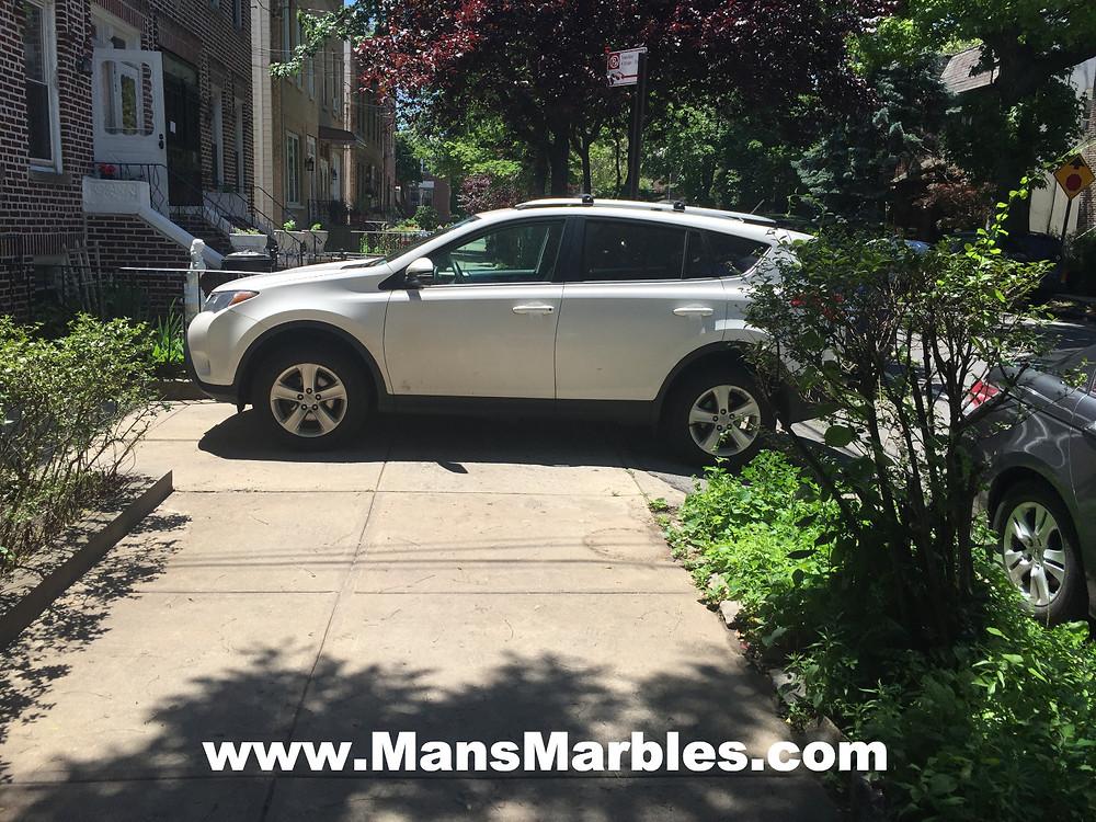 Car parked on sidewalk instead using their driveway #3